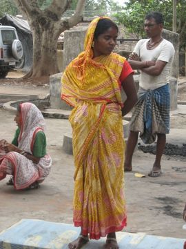 This young woman is wearing the bright colors favored in the Purulia Region.