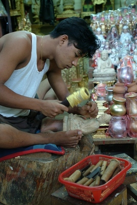 This man is making a statue of Buddha to sell. Buddhism is the government-recognized religion in Myanmar.