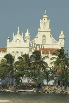 In this tropical village in the South Tamil Nadu Region, a Catholic church stands above other structures and trees.