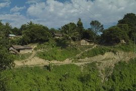 A typical tribal village sits on a hillside in South Tripura.