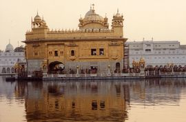 The Golden Temple in Amritsar contains Sikh holy scriptures and stands at the heart of Sikhism.