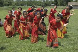 These Assamese children have learned at an early age to value their tribe's unique dress, music and dance.