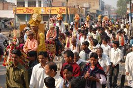 A traditional wedding procession winds its way through the streets of this small town in the Varanasi Region.