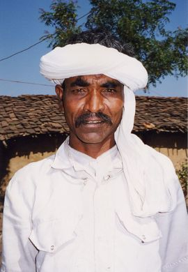 A Bhil man is wearing the characteristic turban of his tribe.