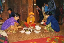 Mealtimes are shared on a mat on the floor in most homes in the West Myanmar Region.