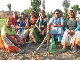 These women are resting after a long day of working the fields.