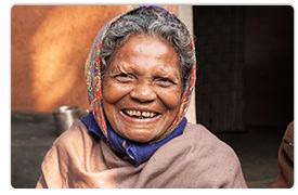 Kishori smiles with her husband