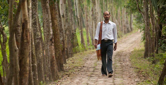 a national worker walking down a path