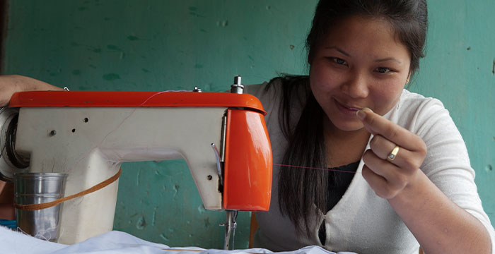 woman with sewing machine from GFA World