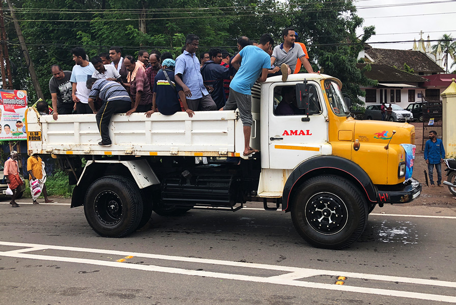 Survivors rescued from Kerala floods arrive at a relief camp