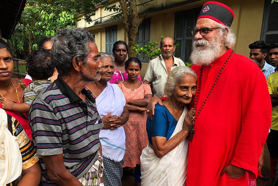 KP Yohannan visits with Kerala flood survivor