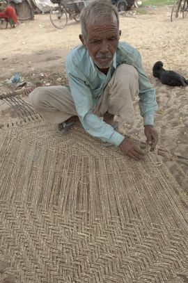 This man from the North Haryana Region demonstrates the skill and patience required to weave a mat by hand.