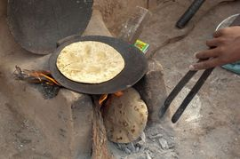 Chapatti bread, a staple food in North Haryana, is cooked over an open fire.